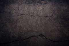 Cement background with cracked leather. Black background, broken, dirty and scary Stock Images