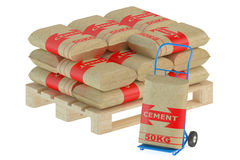 Cement bags on pallet with hand truck Royalty Free Stock Photos
