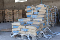 Cement bags in a row on the Palace in the shed. Stock Photography