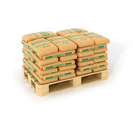 Cement bags stack on wooden pallet. Isolated on white background. 3D illustration Royalty Free Stock Images