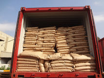 Cement bags. Stacked inside truck stock images
