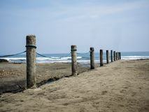 Cement barrier at the beach royalty free stock photography