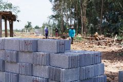 Cement Block In construction site. Builders are building a school fence wall stock photography