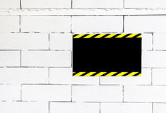 Cement block wall with blank warning poster,template to fill you Royalty Free Stock Images