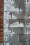 Cement Block Wall with Brick Edge. A gray cement cinder block wall with peeling paint with a brick border on the left stock images