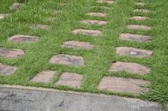 Cement blocks on green grass Royalty Free Stock Photo
