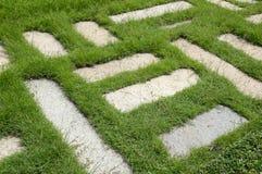 Cement blocks on green grass Royalty Free Stock Photos