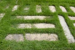 Cement blocks on green grass Royalty Free Stock Photography