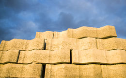Cement bricks. In rows at blue sky Royalty Free Stock Images