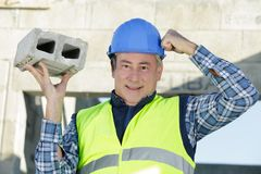 Cement bricks for construction work. Man royalty free stock photography