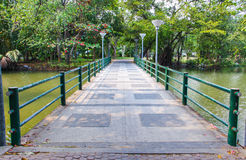 Cement bridge over pond Royalty Free Stock Photography