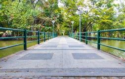 Cement bridge over pond Stock Images
