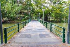 Cement bridge over pond Stock Image