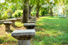 Cement chair in a park,green nature playground, Stock Images