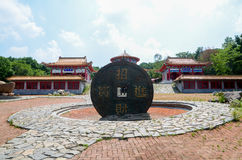 Cement Coin and Taoist architecture Royalty Free Stock Images