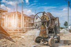 Cement concrete mixer machine at new house building construction. Site stock photos