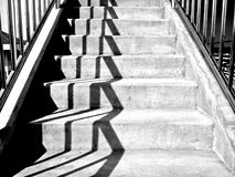 Cement concrete staircase with sunshine in black and white color mode.  Stock Photography