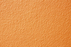 cement and concrete texture with orange painted for pattern and Stock Photos