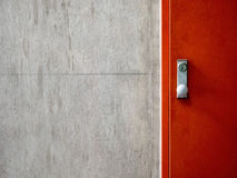 Cement concrete wall texture with modern red door Royalty Free Stock Images