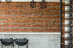 Cement counter nightclub with seat bar stool and brick wall Stock Photos