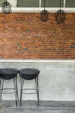 Cement counter nightclub with seat bar stool and brick wall Stock Photo