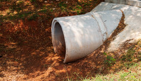 Cement drain pipe. Under the road Stock Images