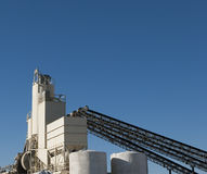 Cement Factory. Conveyors and silos at a cement factory Stock Images