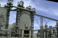 Cement factory, band and storage towers Royalty Free Stock Photography