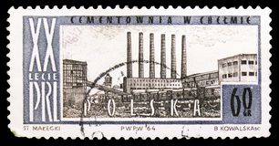 Cement factory, Chelm, Polish people's Republic, 20th anniversary serie, circa 1964. MOSCOW, RUSSIA - SEPTEMBER 15, 2018: A stamp printed in Poland shows Cement royalty free stock photo