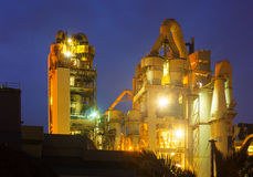Cement factory in evening Royalty Free Stock Image