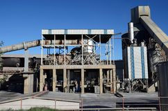 Cement factory kiln. Part of the cement factory royalty free stock photography