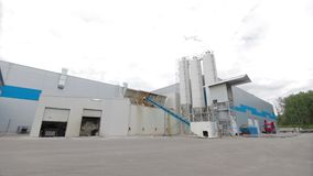 Modern Cement factory. Cement factory machinery on a clear blue day stock video