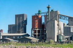 Cement factory machinery on a clear blue sunny day. Industry royalty free stock photos
