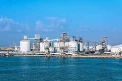 Cement factory. Modern cement factory at waterfront Royalty Free Stock Photo