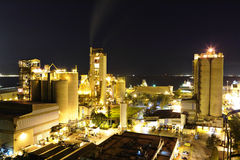 Cement factory at night Stock Photos