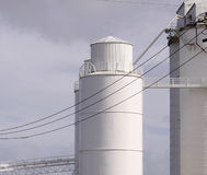 Cement factory silo and tower Royalty Free Stock Image