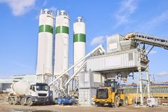 Cement factory at sunny day. Industrial area stock images