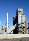 Cement factory towers. Part of the cement factory royalty free stock photo