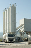 Cement factory and a truck loading cement Stock Photos