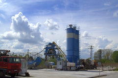 Cement factory. With cement trucks against spring cloudy sky.Picture taken on April 20th,2014 stock image