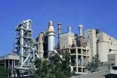 Cement factory view blue sunny day Royalty Free Stock Image