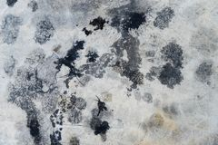 Cement floor with engine oil splash for texture. Background royalty free stock images