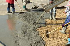 Cement floor. Worker pouring cement for building the flooring Royalty Free Stock Image