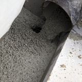 Cement flowing out of a pipe Stock Photography