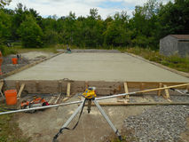 Newly poured cement foundation. Cement foundation, substructure, building surrounded by nature Stock Photography