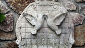 Cement Fountain With Two Doves In Rock Wall. Rock Wall With Cement Fountain Two Doves stock video