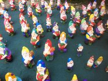 Cement garden dwarfs expose for sell. Cement garden dwarfs expose in a garden toy factory from Romania royalty free stock photo