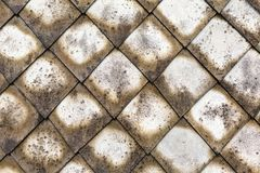 Cement gray old roof weathered surface covered with mold background roof mosaic. Cement gray old roof weathered surface covered with mold pattern background roof Royalty Free Stock Photography