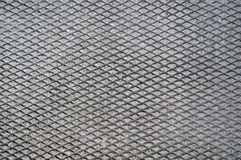 Cement Grid Indent On Asphalt Stock Photo