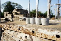 Cement lumps at the construction site. Cement lumps for spacing and supporting the concrete covering work at the construction process Stock Photo